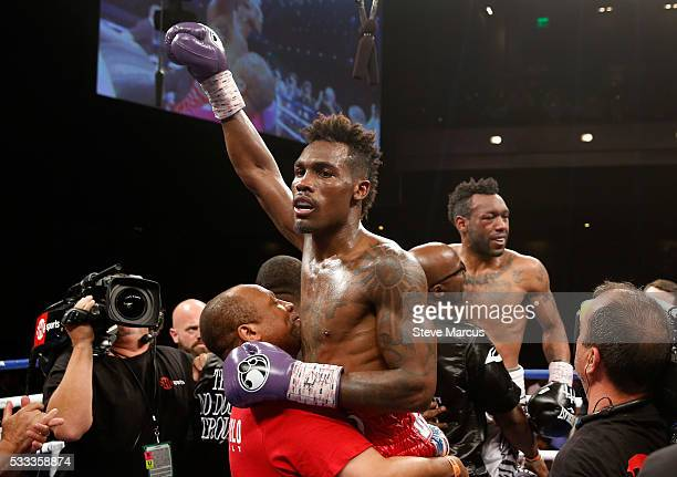 Junior middleweight champion Jermall Charlo celebrates after defeating Austin Trout during their title fight at The Chelsea at The Cosmopolitan of...