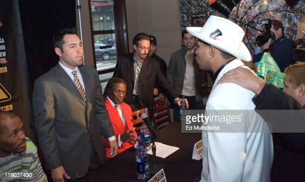 WBC Junior Middleweight Champion Ricardo El Matador Mayorga right faces off with challenger The Golden Boy Oscar De La Hoya at a press conference at...