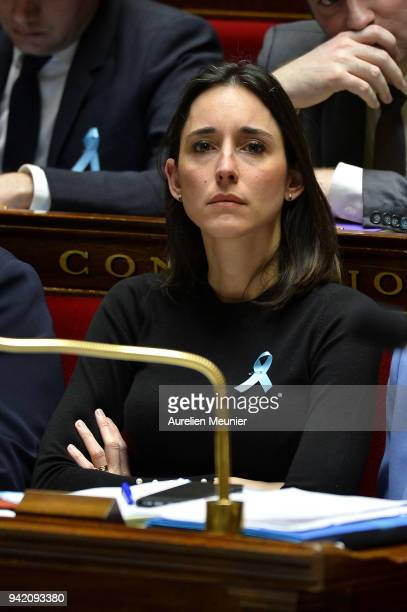 Junior Minister Brune Poirson reacts as Ministers answer deputies during the weekly session of questions to the government at Assemblee Nationale on...
