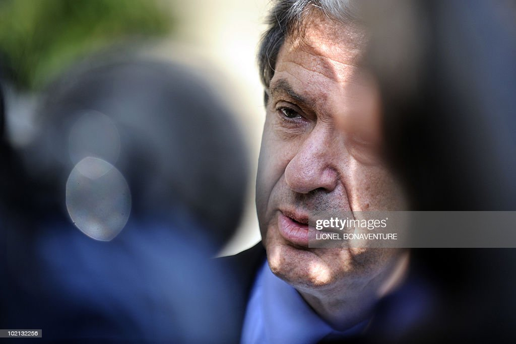 Junior Minister for Urban Affairs Christian Blanc answers journalists questions as he leaves the Elysee presidential palace at the end of the weekly cabinet meeting on June 16, 2010 in Paris.
