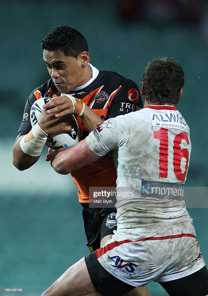 Junior Moors of the Tigers is tackled during the round 23 NRL match between the Wests Tigers and the St George Illawarra Dragons at Allianz Stadium on August 11, 2012 in Sydney, Australia.