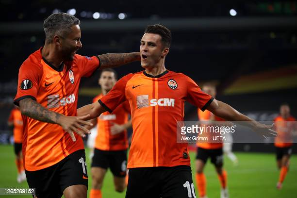 Junior Moraes of Shakhtar Donetsk celebrates with teammate Marlos after scoring his sides first goal during the UEFA Europa League Quarter Final...
