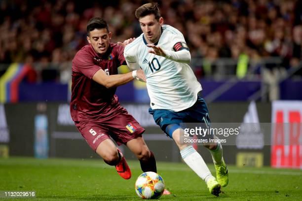 Junior Moreno of Venezuela Lionel Messi of Argentina during the International Friendly match between Argentina v Venezuela at the Estadio Wanda...
