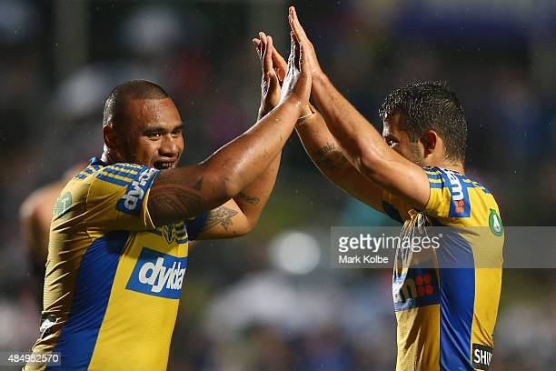 Junior Paulo and Luke Kelly of the Eels celebrate victory during the round 24 NRL match between the Manly Warringah Sea Eagles and the Parramatta...