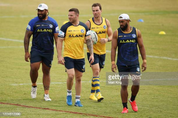 Junior Paulo, Nathan Brown, Clinton Gutherson and George Jennings warm up during a Parramatta Eels NRL training session at Kellyville Park on May 13,...