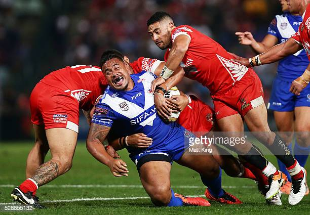 Junior Paulo of Samoa is tackled during the International Rugby League Test match between Tonga and Samoa at Pirtek Stadium on May 7 2016 in Sydney...