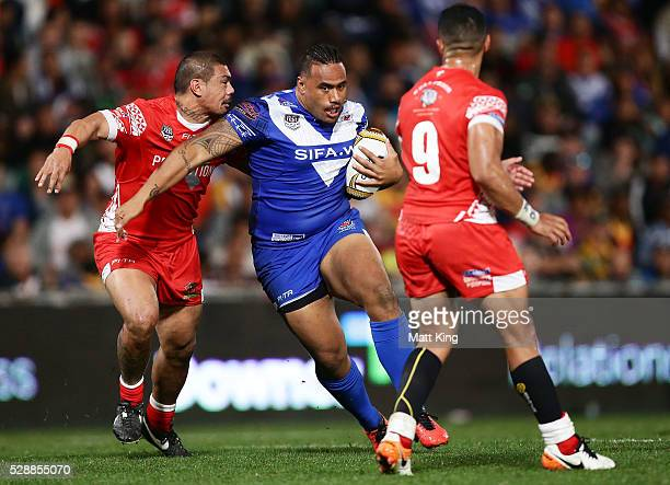 Junior Paulo of Samoa takes on the defence during the International Rugby League Test match between Tonga and Samoa at Pirtek Stadium on May 7 2016...