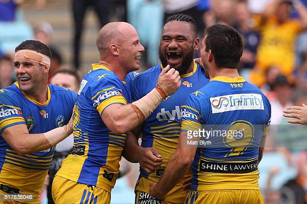 Junior Paulo of the Eels celebrates scoring a try during the round four NRL match between the Wests Tigers and the Parramatta Eels at ANZ Stadium on...