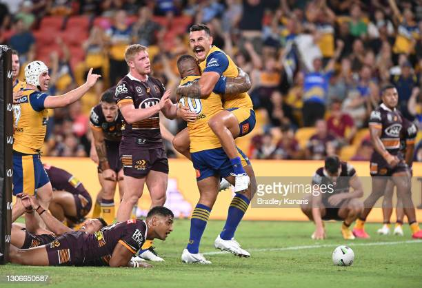 Junior Paulo of the Eels celebrates with Reagan Campbell-Gillard of the Eels after scoring a try with team mates during the round one NRL match...