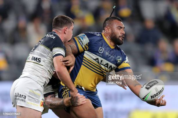 Junior Paulo of the Eels is tackled during the round eight NRL match between the Parramatta Eels and the North Queensland Cowboys at Bankwest Stadium...