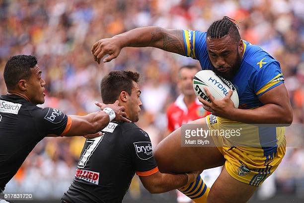 Junior Paulo of the Eels is tackled during the round four NRL match between the Wests Tigers and the Parramatta Eels at ANZ Stadium on March 28 2016...
