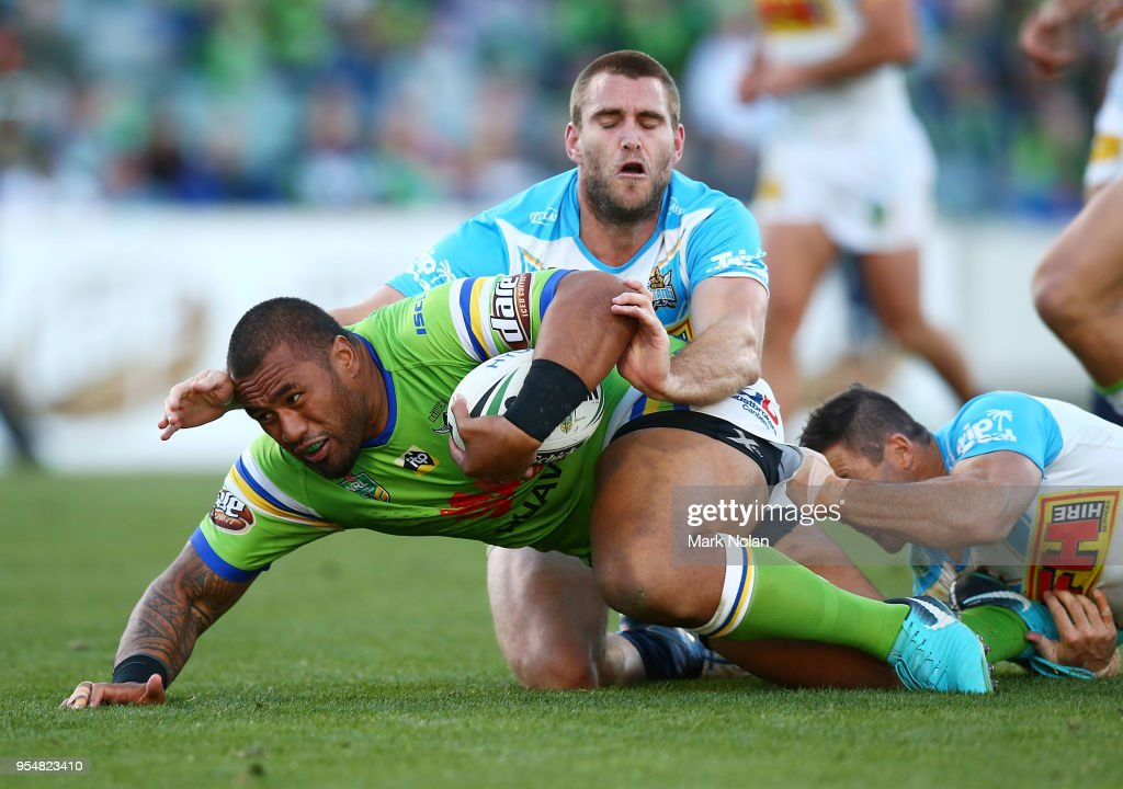 Junior Paulo of the Raiders is tackled during the round nine NRL match between the Canberra Raiders and the Gold Coast Titans at GIO Stadium on May 5, 2018 in Canberra, Australia.