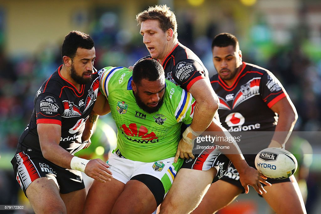 Junior Paulo of the Raiders looks to offload the ball during the round 20 NRL match between the Canberra Raiders and the New Zealand Warriors at GIO Stadium on July 23, 2016 in Canberra, Australia.