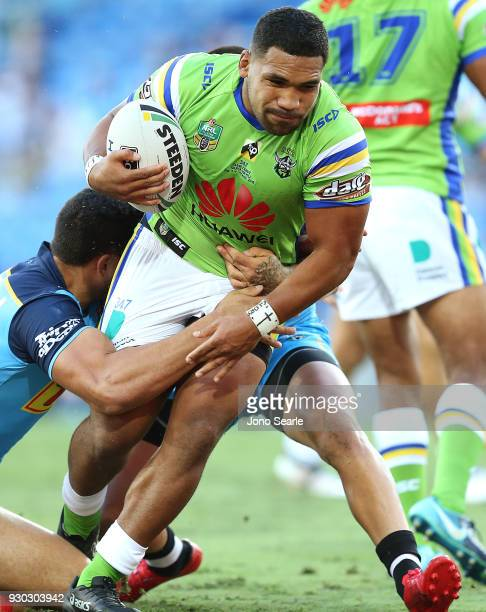 Junior Paulo of the Raiders runs in for a try during the round one NRL match between the Gold Coast Titans and the Canberra Raiders at Cbus Super...