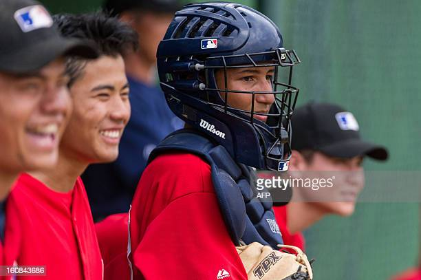Junior players watch a game at the Major Baseball League Elite Camp in Yakult training center, in Ibiuna, about 60 km west of Sao Paulo, Brazil, on...