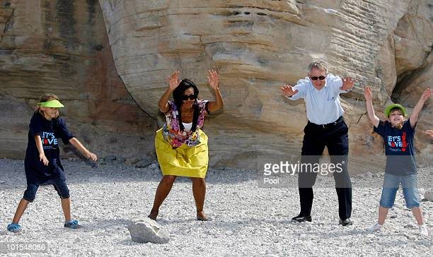 Junior rangers Paige Owens and Kayla Salehian, help first lady Michelle Obama and Sen. Harry Reid, at the Red Rock Canyon National Conservation Area...