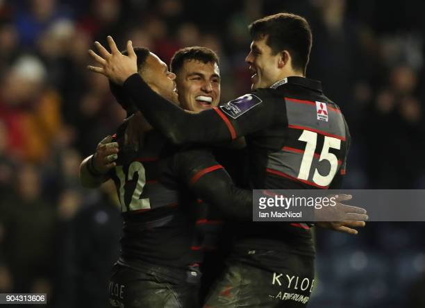 Junior Rasolea of Edinburgh Rugby is congratulated by team mate Damien Hoylandafter he scores his team's third try during the European Rugby...