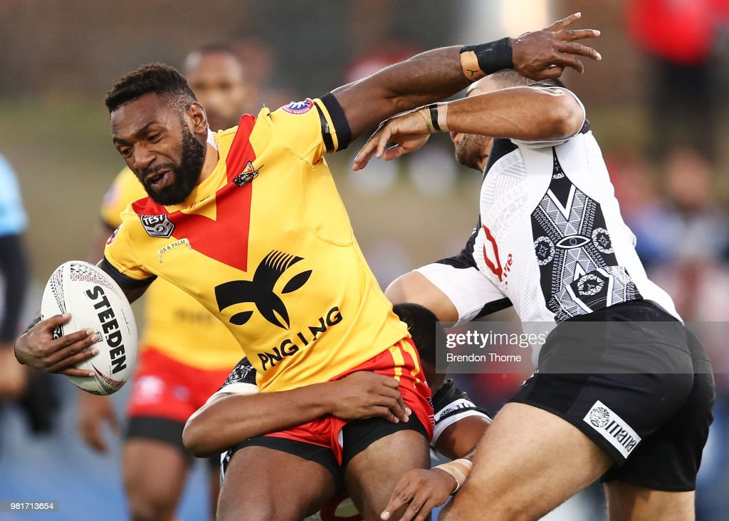 Junior Rau of PNG is tackled by the Fijian defence during the 2018 Pacific Test Invitational match between Fiji and Papua New Guinea at Campbelltown Sports Stadium on June 23, 2018 in Sydney, Australia.