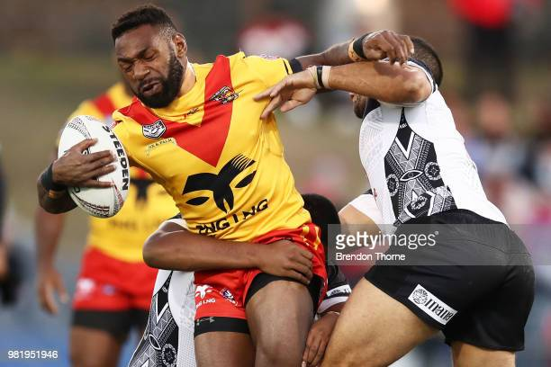 Junior Rau of PNG is tackled by the Fijian defence during the 2018 Pacific Test Invitational match between Fiji and Papua New Guinea at Campbelltown...