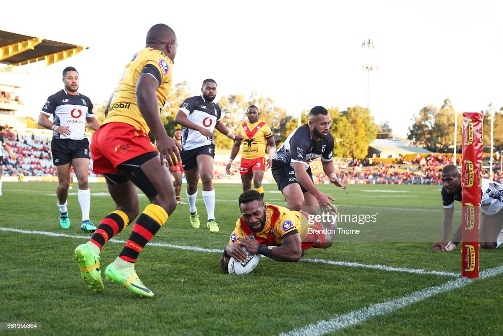Junior Rau of PNG scores a try during the 2018 Pacific Test Invitational match between Fiji and Papua New Guinea at Campbelltown Sports Stadium on June 23, 2018 in Sydney, Australia.