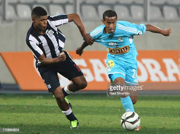 Junior Ross of Sporting Cristal fights for the ball with Wilder Cartagena of Alianza Lima during a match between Sporting Cristal and Alianza Lima as...