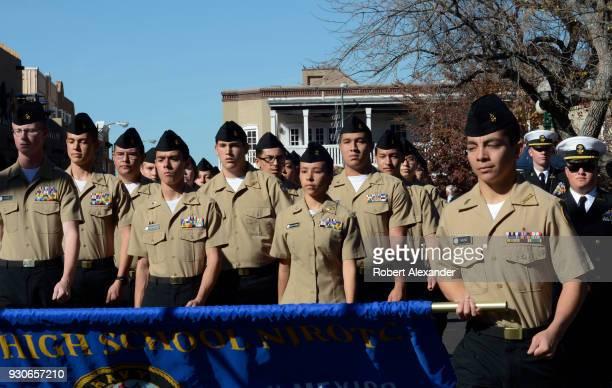 Junior ROTC cadets from Santa Fe High School march in Veterans Day parade in Santa Fe New Mexico