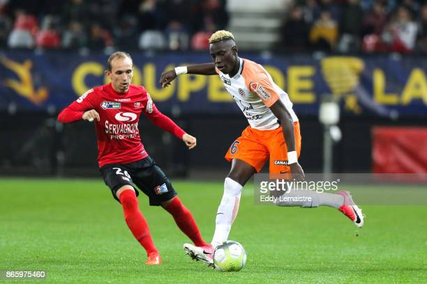 Junior Sambia of Montpellier and Thibault Giresse of Guingamp during the French League Cup match between EA Guingamp and Montpellier Herault SC on...