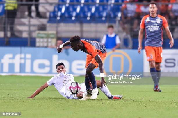 Junior Sambia of Montpellier and Youcef Atal of Nice during the Ligue 1 match between Montpellier and Nice at Stade de la Mosson on September 22 2018...