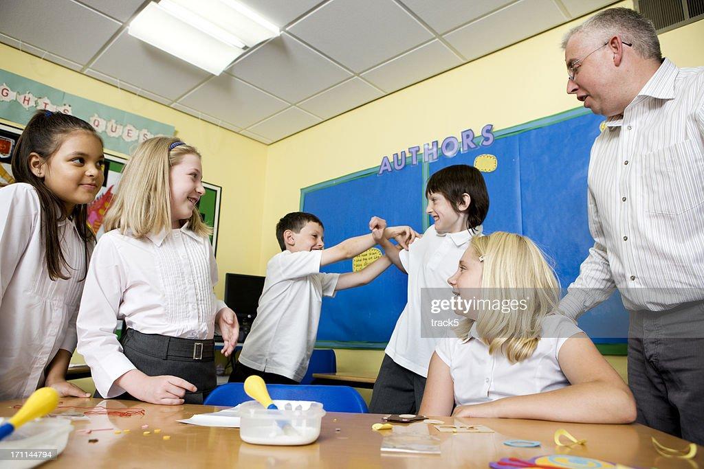 junior school: play fighting : Stock Photo