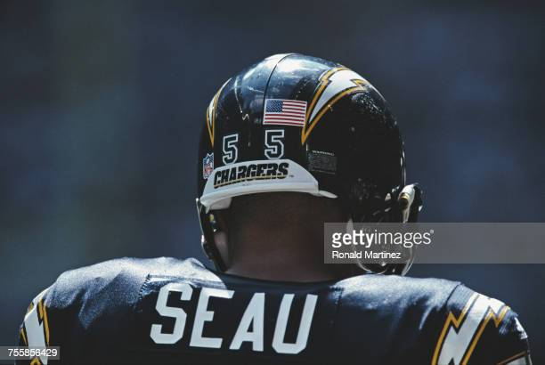 Junior Seau Linebacker for the San Diego Chargers has a stars and stripes sticker placed on his helmet following the terrorist attacks on New York...