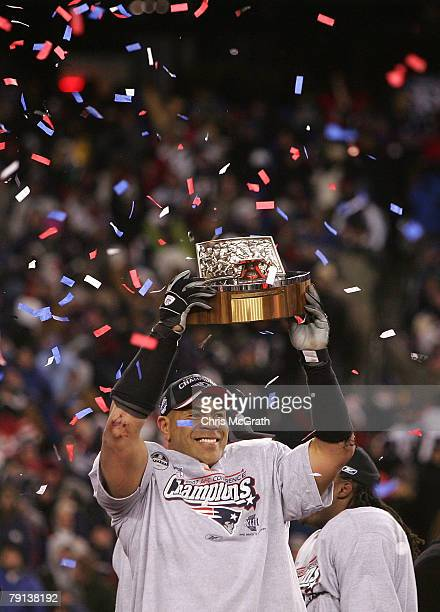 Junior Seau of the New England Patriots celebrates with the Lamar Hunt AFC Championship trophy after the Patriots won 2112 against the San Diego...