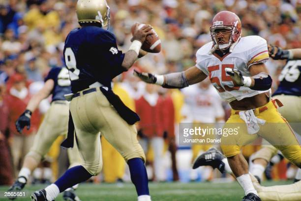 Junior Seau of the University of Southern California Trojans rushes the quarterback of the University of Notre Dame Fighting Irish during the NCAA...