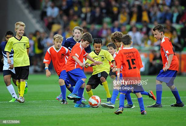 Junior soccer kids playing in the Opening Ceremony before the 2015 Asian Cup match between the Australian Socceroos and Kuwait at AAMI Park on...