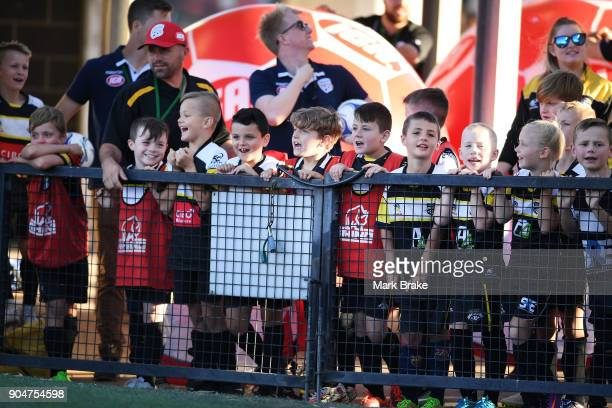 Junior soccer players wait fornthe half time break during the round 16 ALeague match between Adelaide United and Sydney FC at Coopers Stadium on...