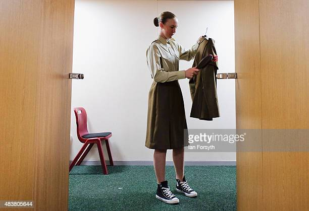 Junior Soldier from 19 Platoon carries out finishing touches to her uniform ahead of a graduation parade at the Army Foundation College on August 13...
