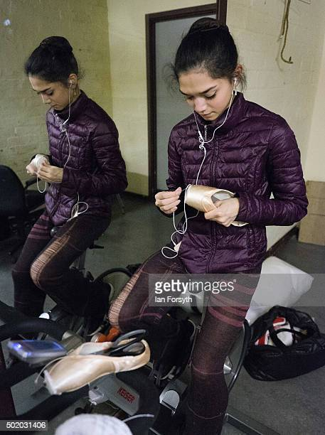 Junior Soloist with Northern Ballet Rachael Gillespie sews her pointe shoes as she stretches her legs on an exercise bike during final rehearsals at...