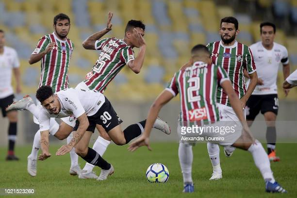 Junior Sornoza and Richard of Fluminense struggles for the ball with Douglas of Corinthians during the match between Fluminense and Corinthians as...
