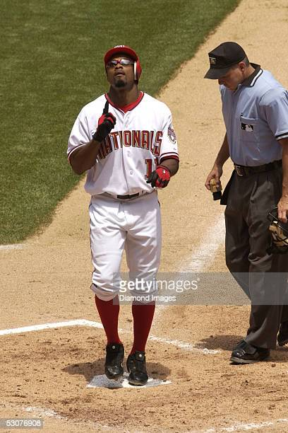 Junior Spivey of the Washington Nationals gives thanks to heaven as he touches homeplate after hitting his first home run for his new team during a...
