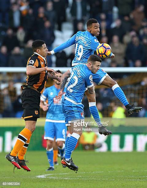 Junior Stanislas of AFC Bournemouth and Jack Wilshere of AFC Bournemouth attempt to head the ball during the Premier League match between Hull City...