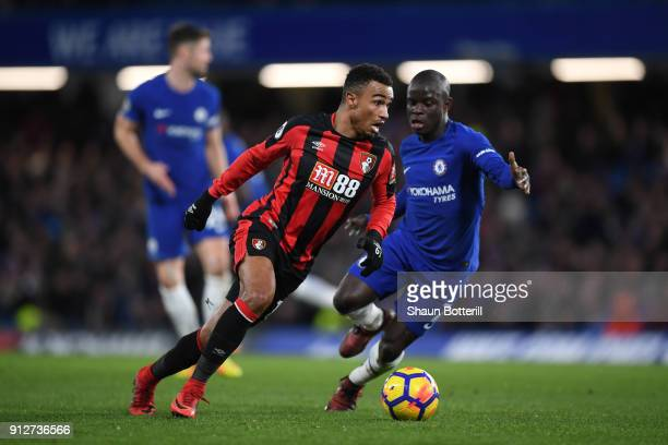 Junior Stanislas of AFC Bournemouth attempts to get away from N'Golo Kante of Chelsea during the Premier League match between Chelsea and AFC...