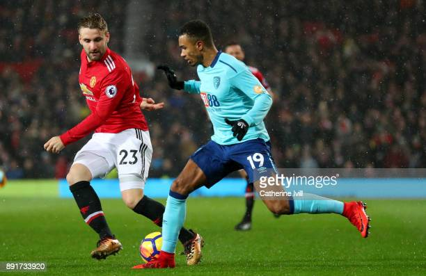 Junior Stanislas of AFC Bournemouth attempts to get past Luke Shaw of Manchester United during the Premier League match between Manchester United and...