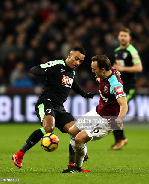 Junior Stanislas of AFC Bournemouth battles for possesion with Mark Noble of West Ham United during the Premier League match between West Ham United...