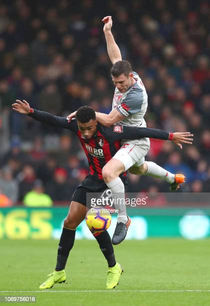 Junior Stanislas of AFC Bournemouth battles for possession with James Milner of Liverpol during the Premier League match between AFC Bournemouth and...