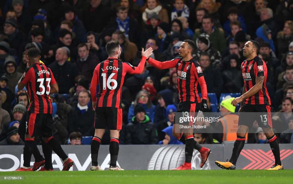 Junior Stanislas of AFC Bournemouth celebrates after scoring his sides second goal with Lewis Cook of AFC Bournemouth during the Premier League match between Chelsea and AFC Bournemouth at Stamford Bridge on January 31, 2018 in London, England.