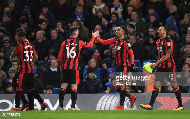 Junior Stanislas of AFC Bournemouth celebrates after scoring his sides second goal with Lewis Cook of AFC Bournemouth during the Premier League match...