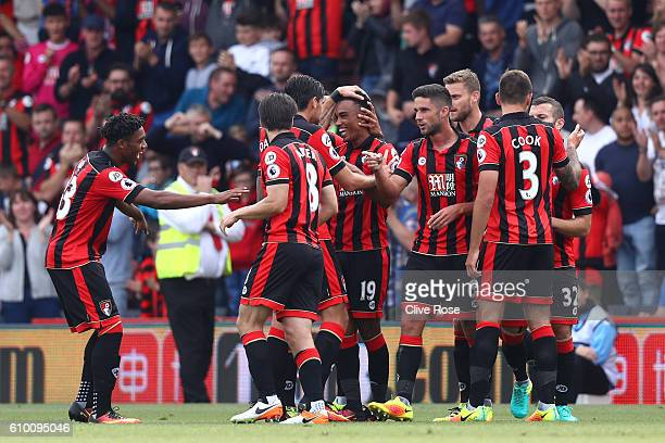 Junior Stanislas of AFC Bournemouth celebrates scoring his sides first goal with his team mates during the Premier League match between AFC...