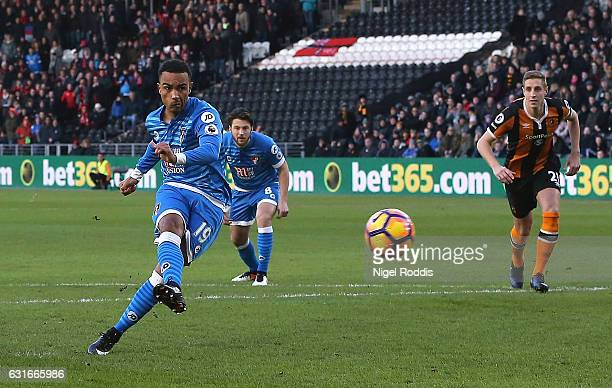 Junior Stanislas of AFC Bournemouth celebrates scoring his sides first goal from the penalty spot during the Premier League match between Hull City...