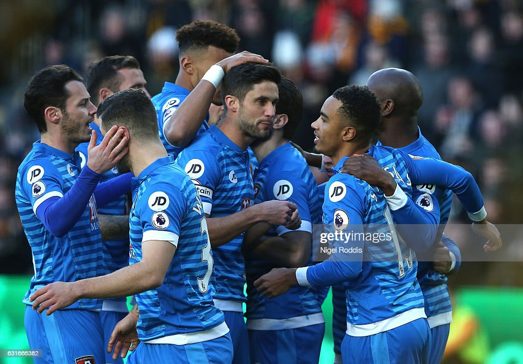 Junior Stanislas of AFC Bournemouth (R) celebrates scoring his sides first goal with his AFC Bournemouth team mates during the Premier League match between Hull City and AFC Bournemouth at KCOM Stadium on January 14, 2017 in Hull, England.