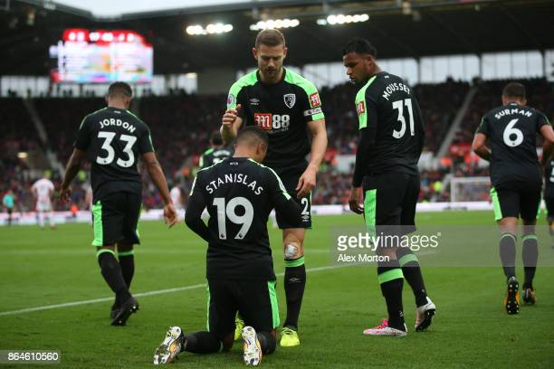Junior Stanislas of AFC Bournemouth celebrates scoring the 2nd Bournemouth goal with team mates during the Premier League match between Stoke City...