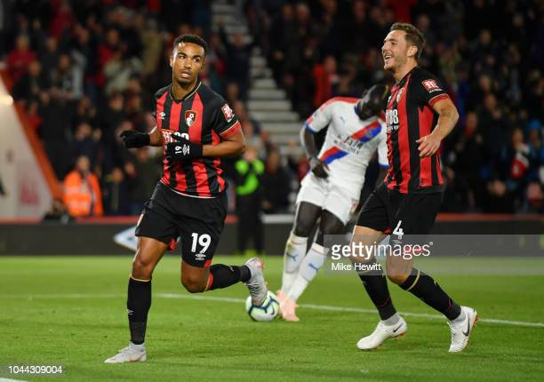 Junior Stanislas of AFC Bournemouth celebrates with Dan Gosling of AFC Bournemouth after he scores his sides second goal from the penalty spot during...